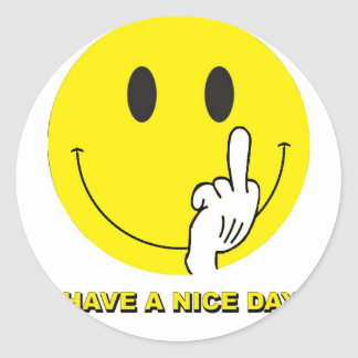 smiley face giving the finger round sticker