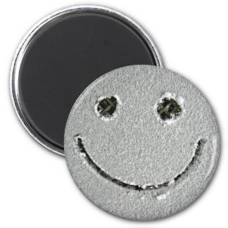 Smiley face of snow. 2 inch round magnet