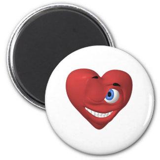 Smiley rojo del corazón que guiña en usted imán de frigorífico