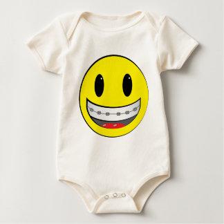 Smiley with braces baby bodysuit
