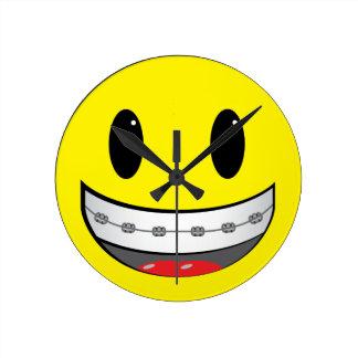 Smiley with braces round clock