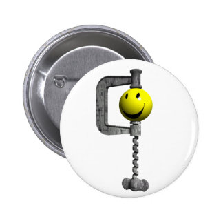 Smiley yellow head caught in a vice pinback button