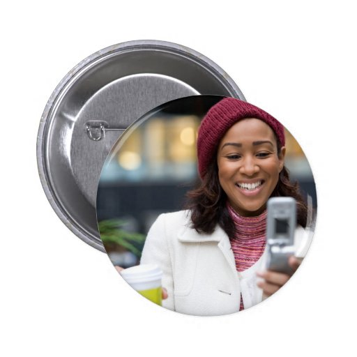 Smiling Business Woman with Cell Phone Pin