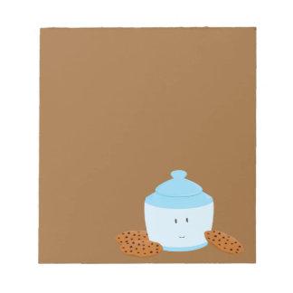 Smiling cookie jar with cookies around it notepad