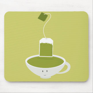 Smiling cup of green tea with tea bag mouse pad