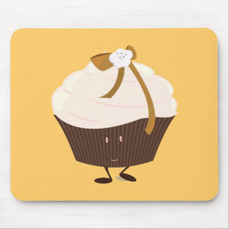 Smiling cupcake with flower and bow mouse pad