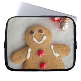 Smiling gingerbread man laptop sleeve