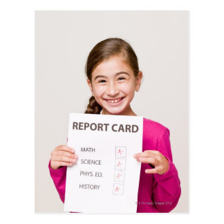 Smiling girl student proud of report card