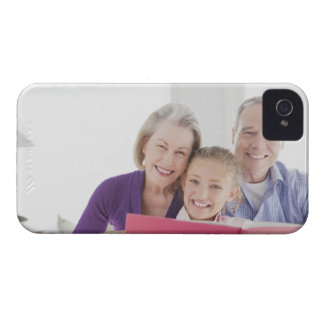 Smiling grandparents reading cookbook with Case-Mate iPhone 4 case