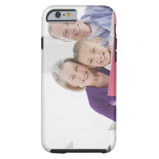 Smiling grandparents reading cookbook with tough iPhone 6 case