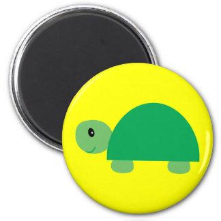 Smiling green cartoon turtle round yellow magnet