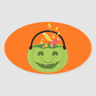 Smiling green Halloween candy bucket Oval Sticker