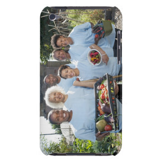 smiling group of workers holding trays of barely there iPod cases