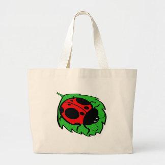 Smiling Ladybug on a Green Leaf Canvas Bag