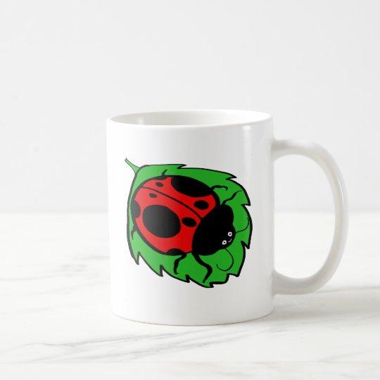 Smiling Ladybug on a Green Leaf Coffee Mug