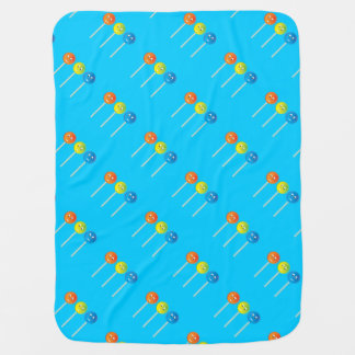 Smiling lollipops receiving blanket