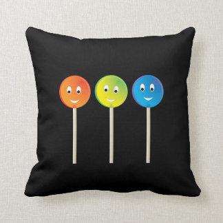 Smiling lollipops throw pillow