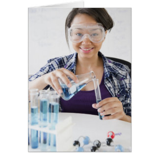 Smiling mixed race teenage girl conducting greeting cards