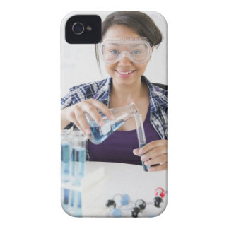 Smiling mixed race teenage girl conducting iPhone 4 cover