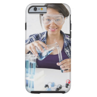 Smiling mixed race teenage girl conducting tough iPhone 6 case
