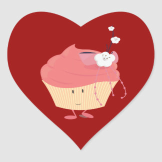 Smiling pink cupcake with flowered branch topping heart sticker