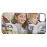 Smiling students peering into microscopes in iPhone 5 cases