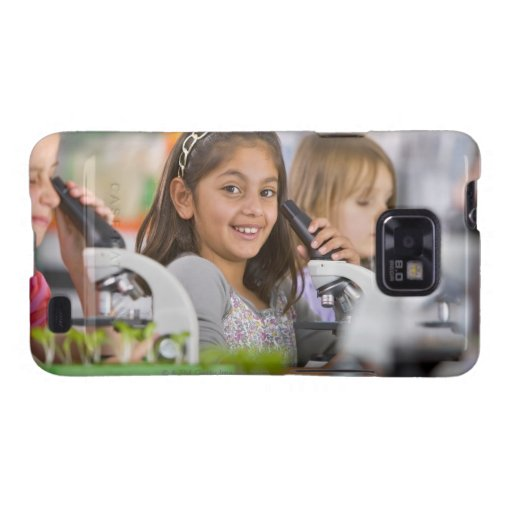 Smiling students peering into microscopes in samsung galaxy s2 covers