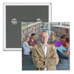 Smiling teacher standing in school library with pinback button