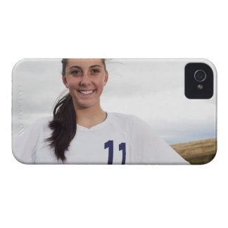 smiling teen girl soccer player w/ soccer ball iPhone 4 cover