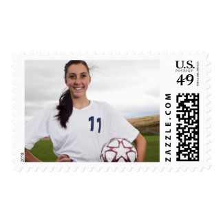 smiling teen girl soccer player w/ soccer ball postage