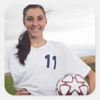 smiling teen girl soccer player w/ soccer ball square sticker