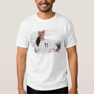 smiling teen girl soccer player w/ soccer ball tshirt
