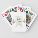 Smiling tooth mascot playing cards