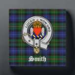 """Smith Family Tartan Plaid and Clan Crest Badge Plaque<br><div class=""""desc"""">This stunning Scottish heritage inspired decorative plaque has the Smith family tartan plaid pattern in blue, green with red and yellow stripes as a background. The Smith Clan Crest Badge is shown with a silver color strap and buckle, blue and yellow wreath and a flaming winged heart. The clan motto...</div>"""