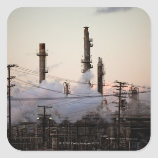 Smoke stacks and distillation towers rise square sticker