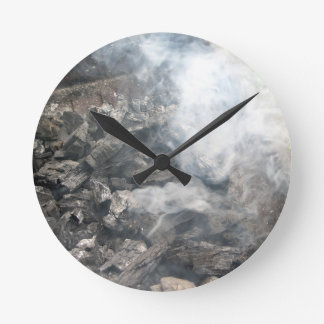 Smoking burning charcoal on barbecue round clock