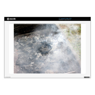 Smoking burning charcoal on barbecue skins for laptops