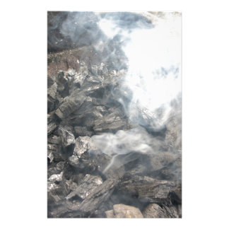 Smoking burning charcoal on barbecue stationery
