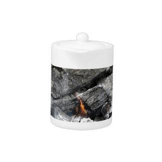 Smoking burning charcoal teapot