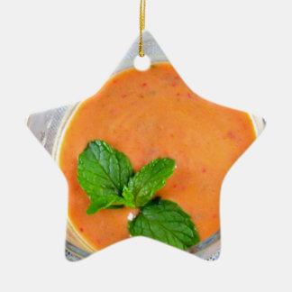 smoothie anaranjado de la zanahoria con licencia adorno de cerámica en forma de estrella