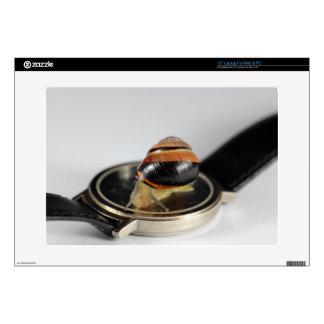 """Snail on a watch 15"""" laptop skins"""