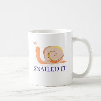 Snailed él taza de café
