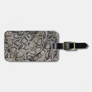 Snake-skin design an effortless dose of  chic luggage tags