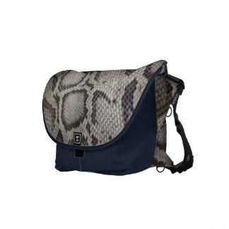 Snake-skin design an effortless dose of  elegance courier bag