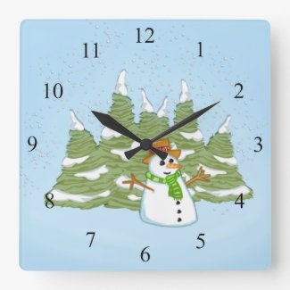 Snoman in Field of Falling Snow Blue Wall Clock