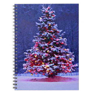 Snow Covered Christmas Tree on a Serene Night Spiral Notebook