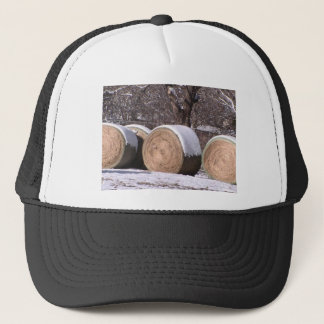 Snow covered hay bales trucker hat