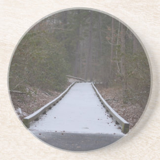 Snow covered jogging path drink coaster