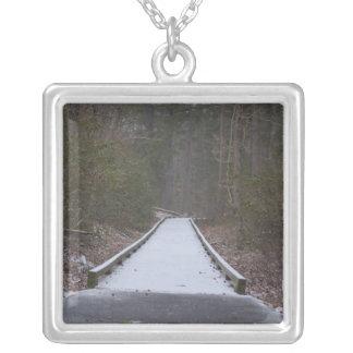 Snow covered jogging path custom jewelry