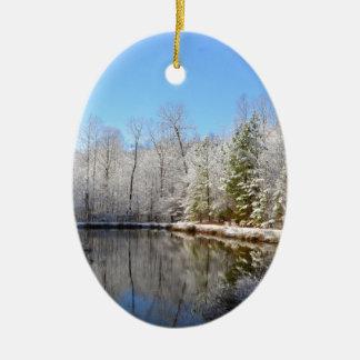 Snow covered landscape around the pond ceramic ornament